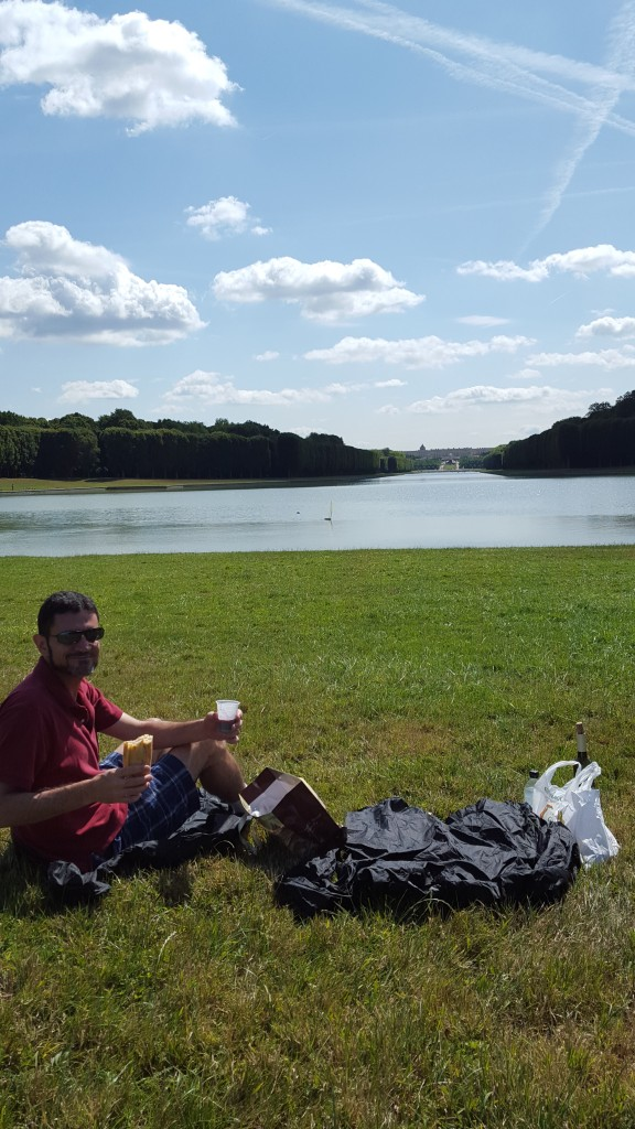 Picnic lunch on the grand canal at Versailles at the end of the mile long canal behind the palace. The canal is cross shaped with treelined paths surrounding it, perfect for biking.